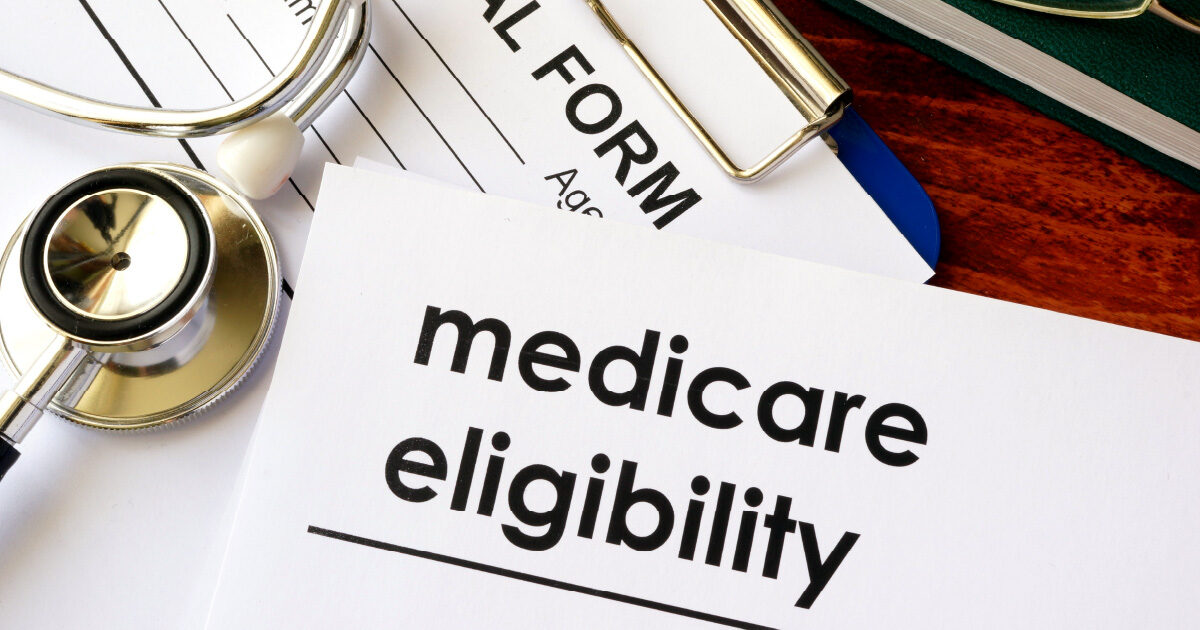 Medicare Eligibility written on a document on a clipboard
