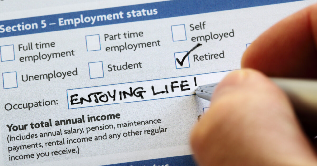 Image of an employment status form, with the box for retirement checked and the words enjoying life written in the occupation box.