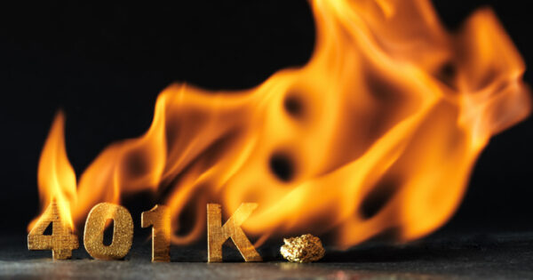 The letters '401K' made from gold blocks are on fire, meant to indicate an oversight has ruined a retirement plan.