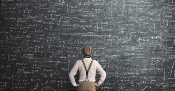 A person looking at a chalkboard filled with complex mathematical calculations. This is meant to represent calculating provisional income or combined income.