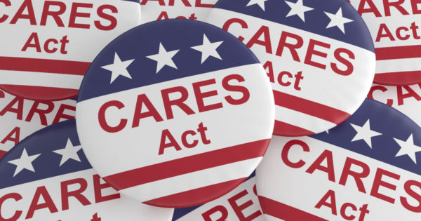"Red white and blue buttons with stars, stripes, and ""CARES Act"". The CARES Act makes important changes to Required Minimum Distributions (RMD's) for Retirement Accounts."