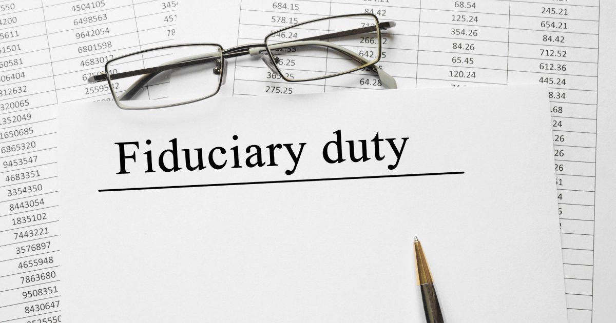 Fiduciary responsibilities of the retirement planning committee – image of a document with a pair of glasses and the words 'fiduciary duty'