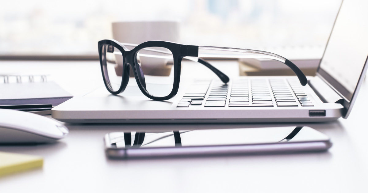 glasses on laptop - find missing participants in your retirement plans