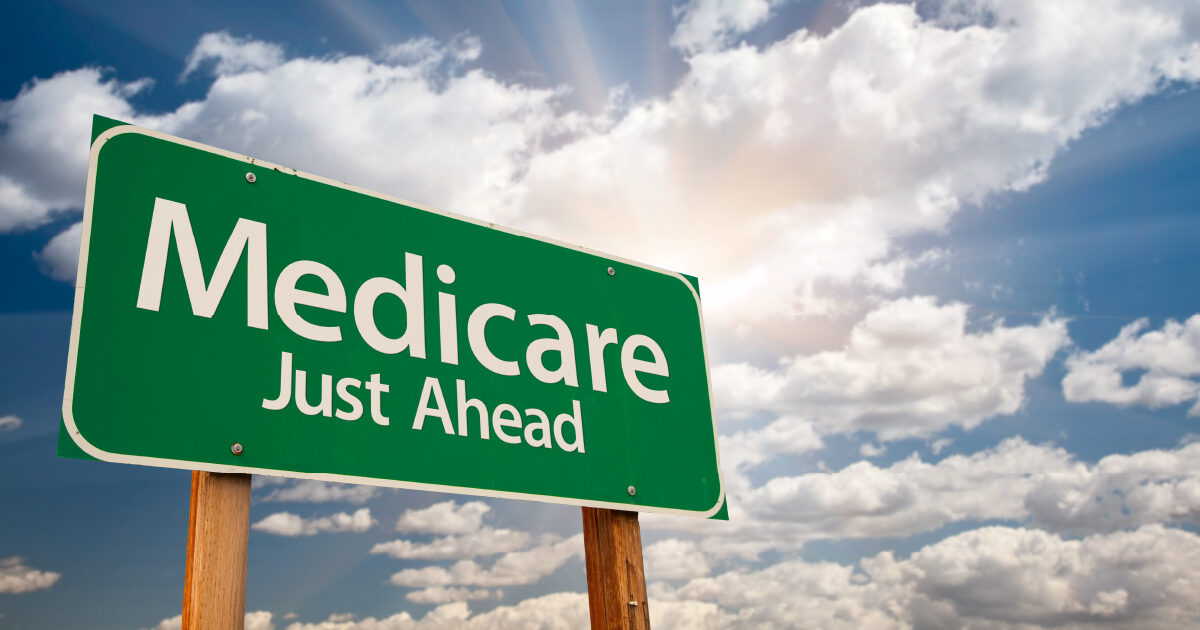 "A traffic sign with ""Medicare Just Ahead"" written on it meant to indicate Medicare Planning"