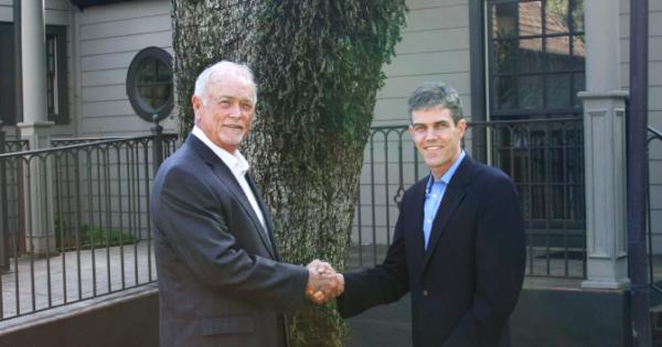 Mark McGarvey shaking hands with new Meld Financial partner Jamie Cornehlsen