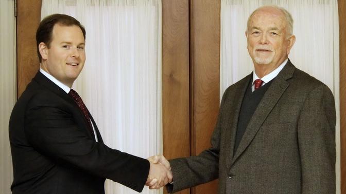 Mark and Kyle shake hands - Kyle Whittington name new partner